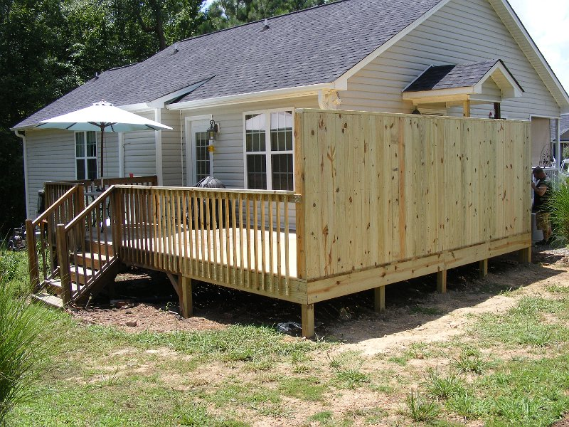 Deck addition with privacy rail