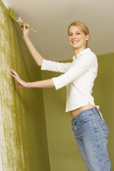 image of woman painting popcorn ceilings