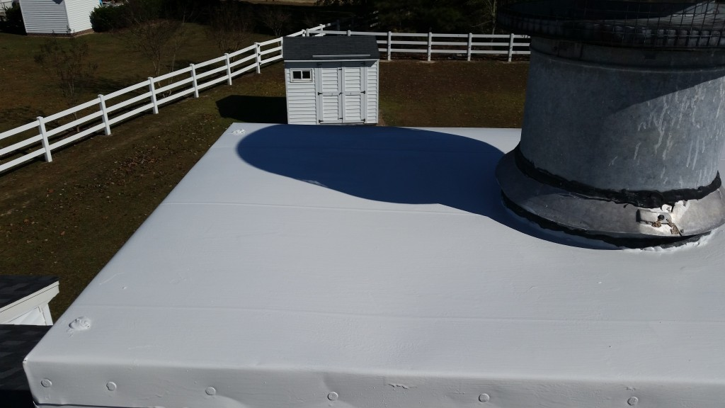 Properly sealed and painted chimney caps protect the chimney and look great